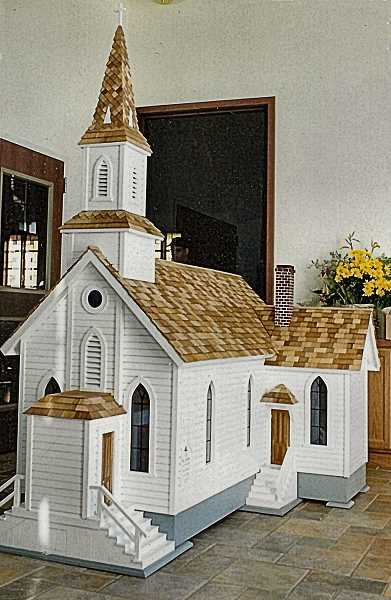 JIM AND ROSE REARDON COURTESY PHOTO - Here is the large scale model of the original St. Johns Episcopal Church, made for the 150th anniversary of the congregation in 2001. Volunteers Jim and Rose Reardon, and friends of  St. Johns donated endless hours and completed the model in less than three months. This model can be viewed in the display window of todays church west-wing offices and meeting places at 20th and S.E. Jefferson in Milwaukie.