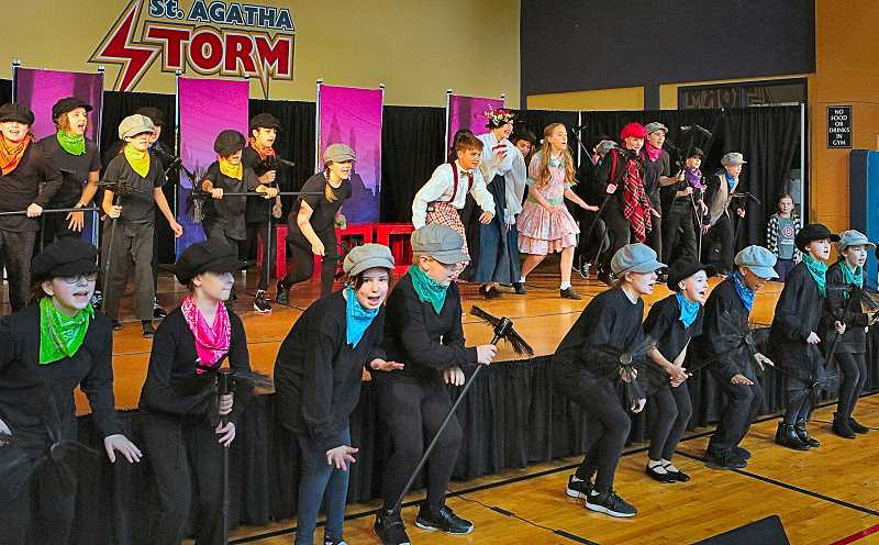 DAVID F. ASHTON - Its the big finish to the rousing number, Chim Chim Cheree - In the St. Agatha Catholic School stage production of Marry Poppins.