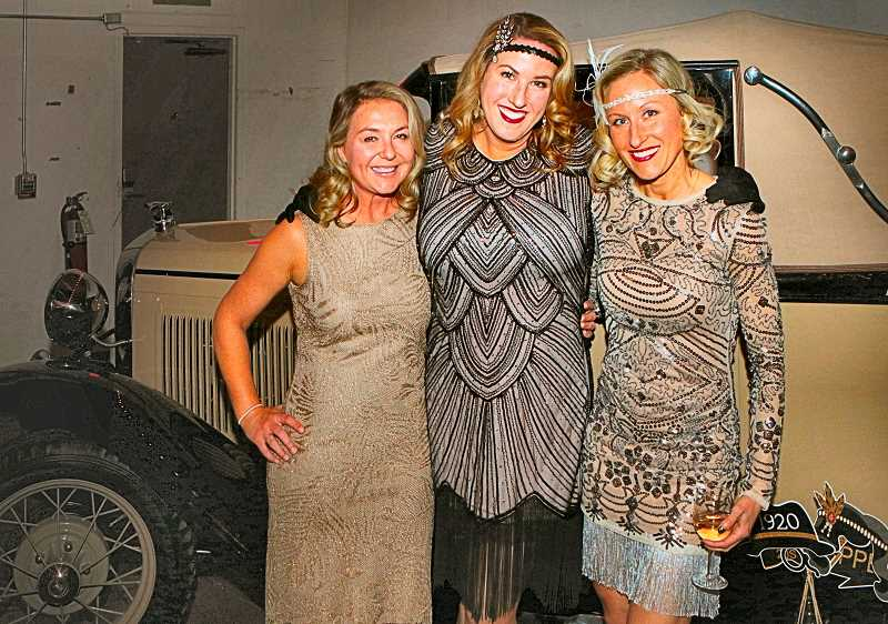 DAVID F. ASHTON - In front of this 1920s automobile, we found these modern flappers - the Duniway fundraisers organizers, Katka Howland, Betsy Roberts, and Erin Gates.