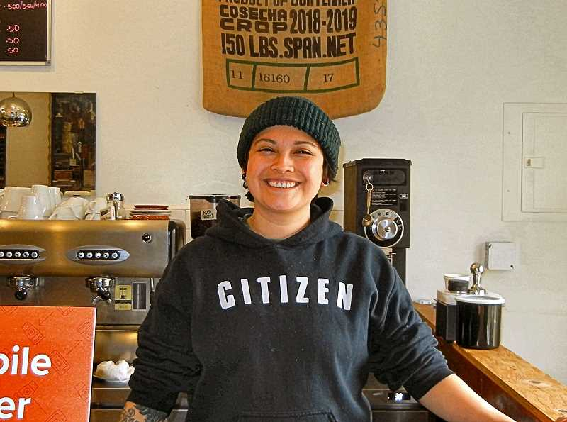 ELIZABETH USSHER GROFF - A new way to order your coffee ahead, via a mobile device, is being tried by Café Zamora in the Creston-Kenilworth neighborhood. Here, Ami Rosales, weekday morning barista, awaits an order in person or online. Theysell homemade tamales there now, too.