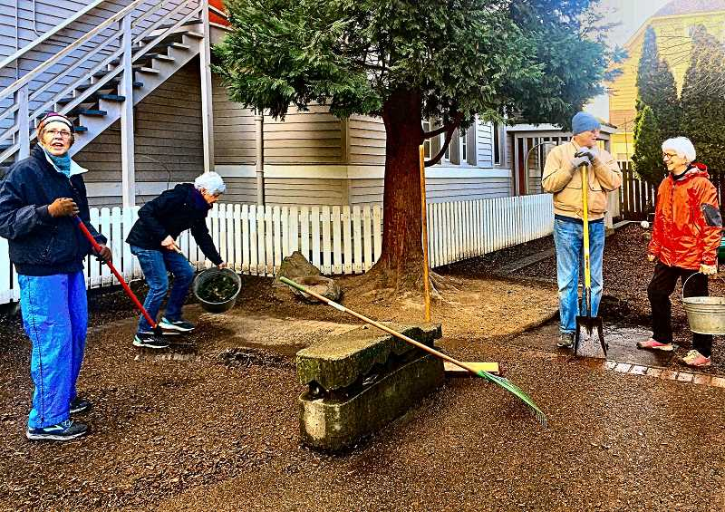 COURTESY PHOTO - JAN MARTENS - Raking, sweeping, and weeding kept the volunteer Work Group of ten seniors busy for an hour on the Sellwood Community House patio on February 29. The four pictured here did work industriously in spite of what the photo may suggest!