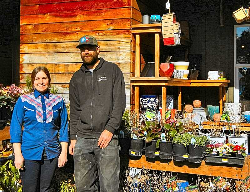 ELIZABETH USSHER GROFF - Billie Jo McGahey and Brock Linder take turns working at the Woodstock Ace Hardware Garden Center, at S.E. 44th and Woodstock Boulevard. The door to the Garden Center is sometimes the only entrance to both stores during the current hardware store renovation.