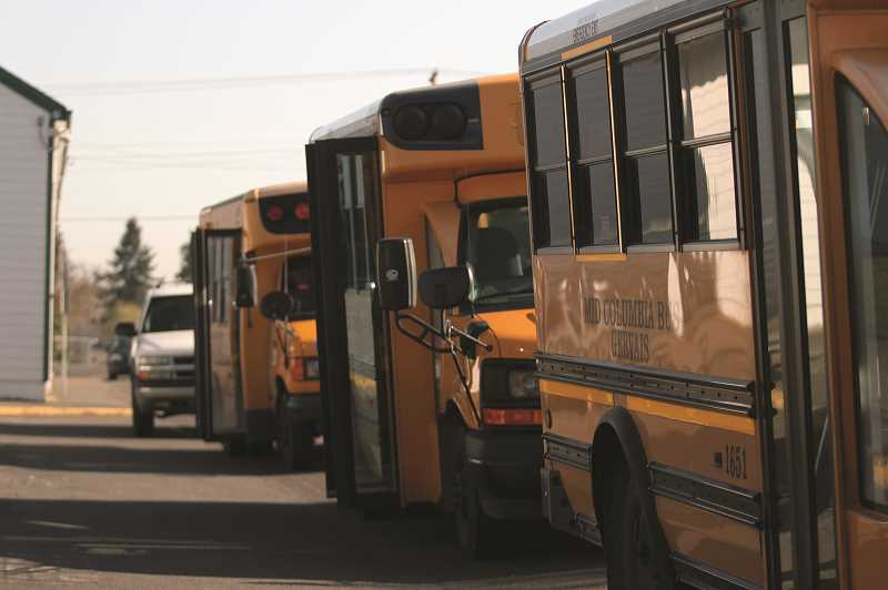 PMG PHOTO: PHIL HAWKINS - Each morning, buses line up at Gervais Elementary School, where they are packed with meals and delivered across the district boundaries that stretch 60 square miles across both sides of I-5.