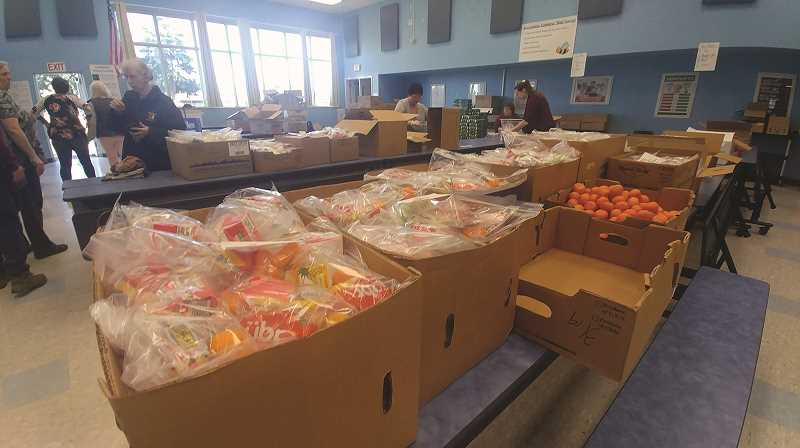PMG PHOTO: PHIL HAWKINS - The Gervais Elementary School cafeteria is the command center for meal preparation, where hundreds of breakfasts and lunches are prepared each day to be delivered to all children ages 1-18 in the district who want them.