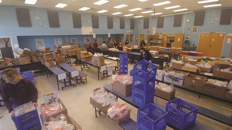 PMG PHOTO: PHIL HAWKINS - The Gervais Elementary School cafeteria is the command center for the lunches, where hundreds of meals are prepared each day to be delivered to all children ages 1-18 in the district who want them.