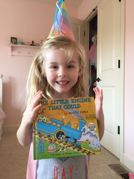 COURTESY PHOTO - Makenna Patterson holds a book on her 5th birthday. She was enrolled in Imagination Library from birth.
