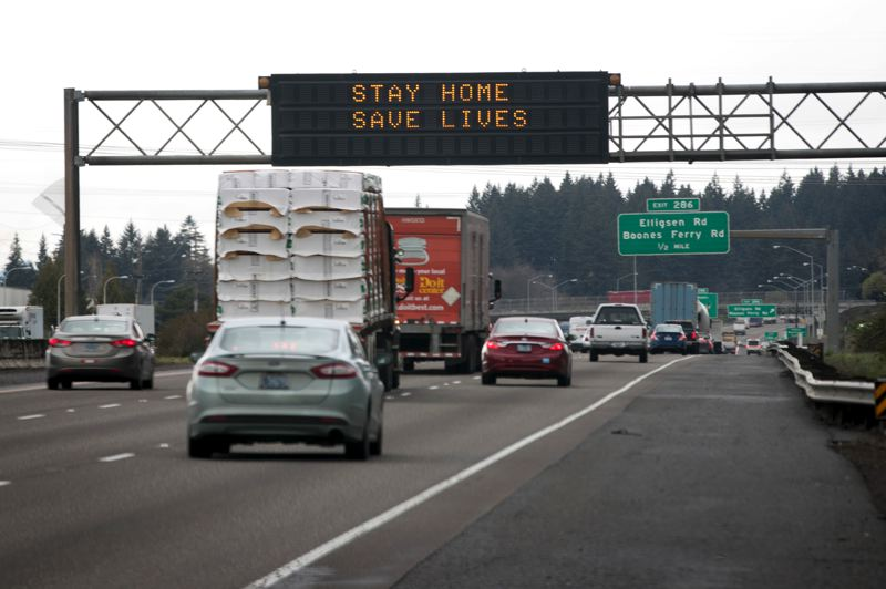 PMG PHOTO: JAIME VALDEZ - Vehicles travel northbound along Interstate 5 by Wilsonville under an LED sign that reads 'Stay Home, Save Lives,' a reference to Gov. Kate Brown's new executive order to stop the spread of the novel coronavirus.
