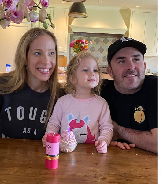 COURTESY PHOTO: MARIEL ZAGUNIS - Mariel Zagunis at home with daughter Sunday and husband Mike Swehla.