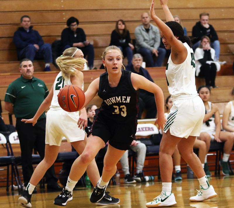PMG PHOTO: DAN BROOD - Sherwood High School sophomore Klaira Ray (center) was an All-Pacific Conference second-team pick for her play in the 2019-20 season.