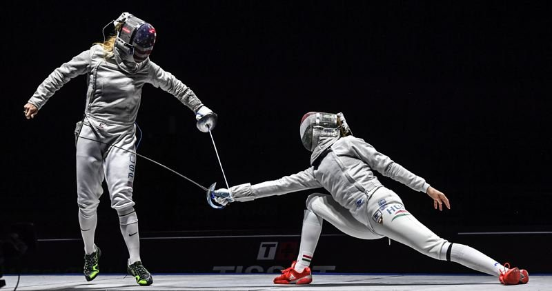 COURTESY PHOTO: US FENCING - Mariel Zagunis (left) competes in Moscow.