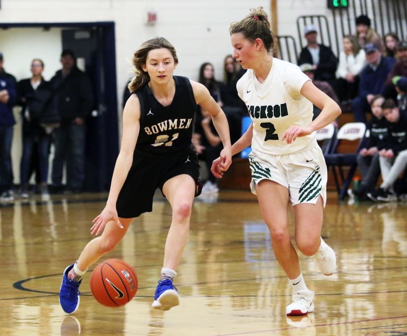 PMG PHOTO: DAN BROOD - Sherwood High School senior guard Ava Boughey (left) was an All-Pacific Conference honorable mention pick for her play in the 2019-20 season.