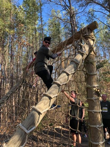 COURTESY PHOTO - Lt. Clayton Simon participated in fitness challenges like climbing the cargo net during his time at the FBI Academy.