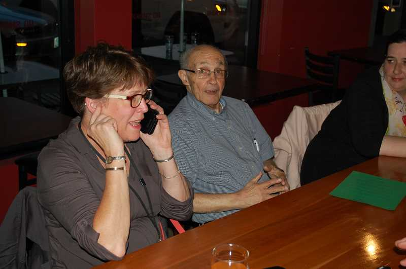 RAYMOND RENDLEMAN - Ledding Library Director Katie Newell (left) and longtime Milwaukie library advocate Ed Zumwalt celebrate after hearing the results on election night in May 2016.