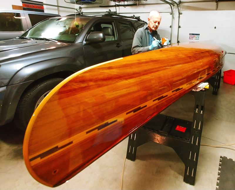 COURTESY PHOTO: THE TEBBENS FAMILY  - Troutdale resident Carl Tebbens is using his time to refinish a canoe he and his wife, Tina, built in 2003.