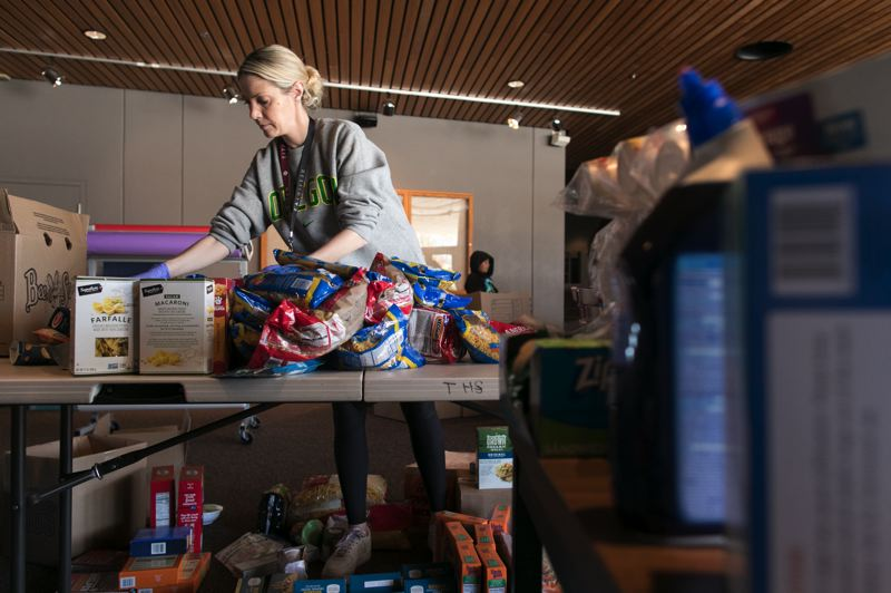 PMG PHOTO: JAIME VALDEZ - Tristan Irvin, a Durham Elementary School teacher and member of Foundation for Tigard-Tualatin Schools, boxes up food.