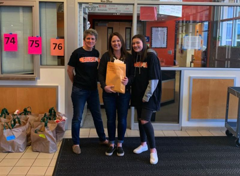 COURTESY PHOTO: BETHANY RICHTER - Beaverton High School principal Anne Erwin, Cedar Mill Bible pastor Bethany Richter and Beaverton sophomore Sydney Richter helped raise $12,500 in food gifts cards for BHS families in need.