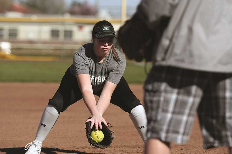 PMG PHOTO: PHIL HAWKINS - With only one senior on the team, the junior class led by pitcher Jasmine Calkins is eager to take over the leadership role and help usher the incoming class of freshmen.