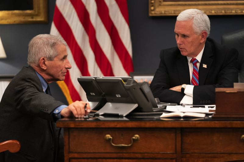 COURTESY PHOTO: THE WHITE HOUSE - Vice President Mike Pense talks with the CDC's Dr. Anthony Fauci, who is leading the national response to the COVID-19 virus. Oregon Gov. Kate Brown told reporters that the federal response to Oregon's request for help has been inadequate.