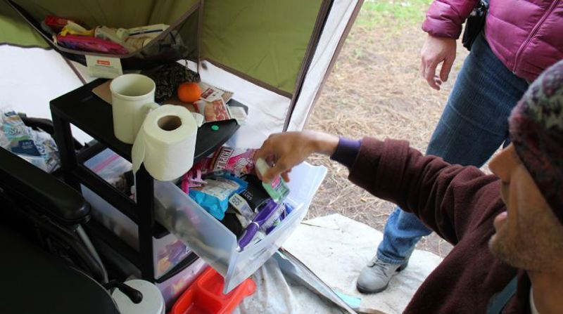 COURTESY PHOTO: STREET ROOTS - Raven Drake keeps hygiene supplies in a medical tent that is part of a homeless camp in Portland.