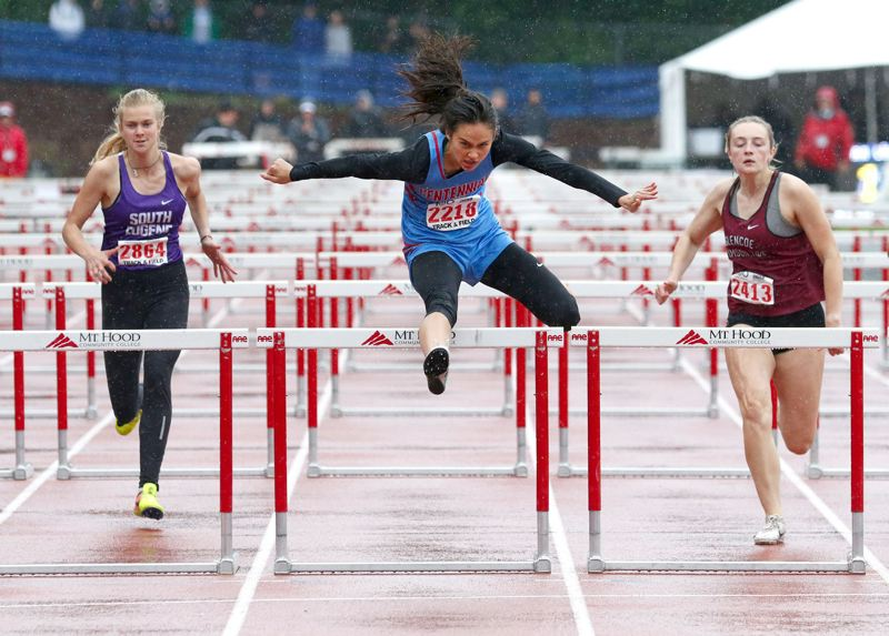 PMG PHOTO: JONATHAN HOUSE - Centennial High graduate Maddie McHone, now at Oregon State, clears a hurdle on her way to a win in last years 6A state meet at Mt. Hood Community College.