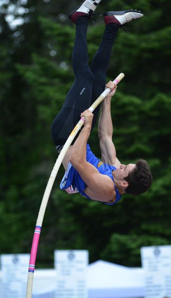 PMG PHOTO: DAVID BALL - Barlows Conrad Greeley sails into the air on his way to second place in last years pole vault competition.