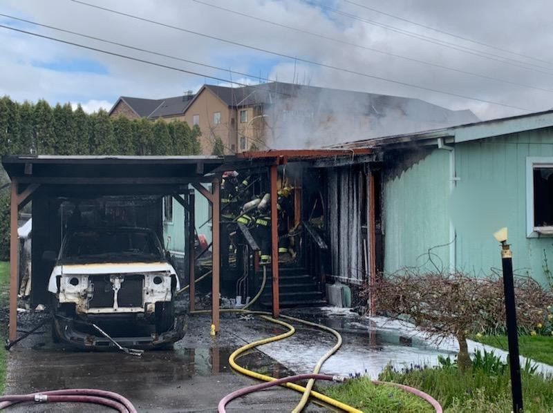 COURTESY TUALATIN VALLEY FIRE & RESCUE/HILLSBORO FIRE - Two mobile homes and a vehicle were destroyed Wednesday, March 25, by a fire in the 5800 block of Northeast Jacobson Street in Hillsboro. Seven people evacuated and there were no injuries. Firefighters responded from Hillsboro city and Tualatin Valley Fire & Rescue.