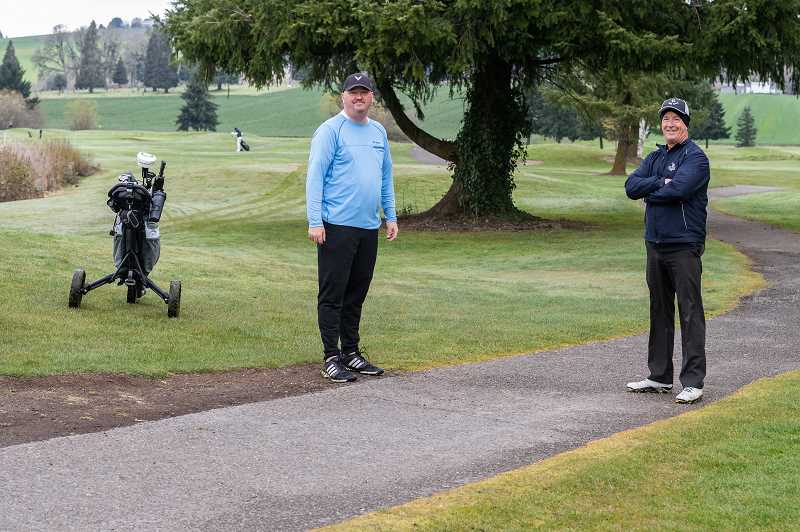 PMG PHOTO: CHRISTOPHER OERTELL - Dan Ellis and Doug Tilson pause for a photo during their round at the Quail Valley Golf Course in Banks, Ore., on Wednesday, March 25, 2020.