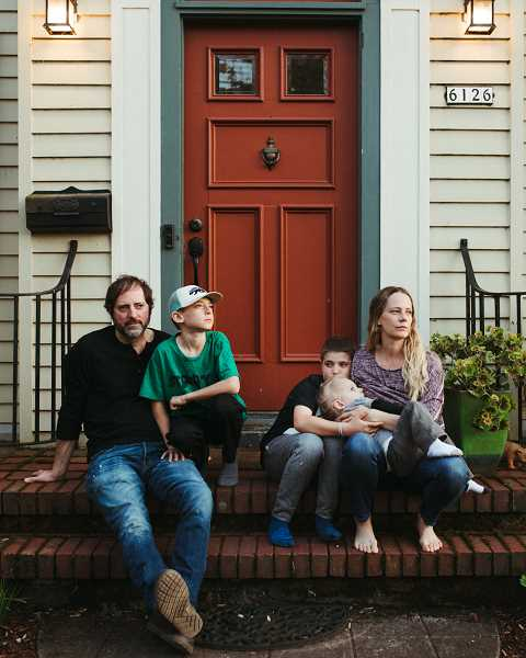 COURTESY PHOTO: NATALIE GILDERSLEEVE - Many parents are required to take care of their children while the stay-at-home order is in place. Natalie Gildersleeve captured this pensive family for her social distancing photography project.