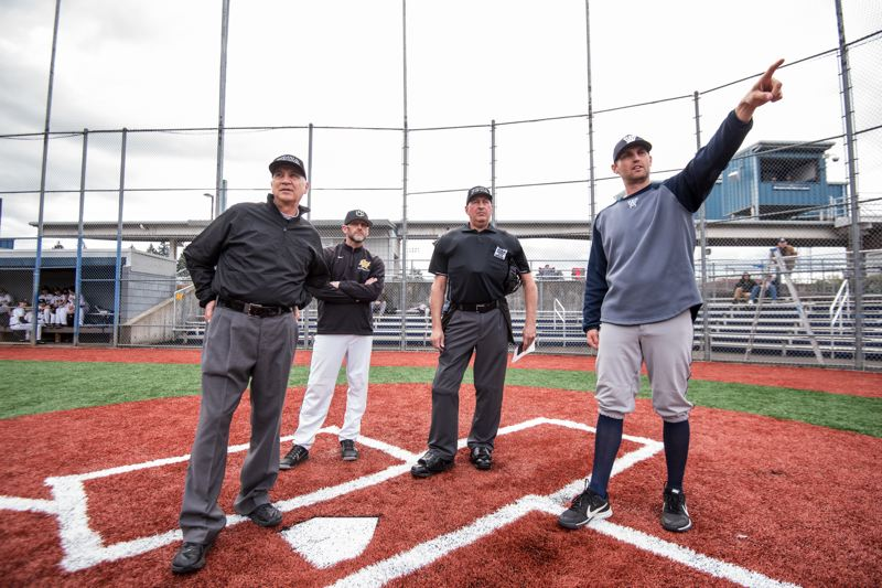 COURTESY PHOTO: GREG ARTMAN - Wilsonville baseball coach Bryn Card points at home plate before a game last year.