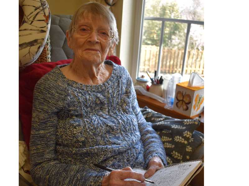 PMG PHOTO: RAYMOND RENDLEMAN - Barbara Hannant works daily to keep up her strength by writing her memoirs in Oregon City.