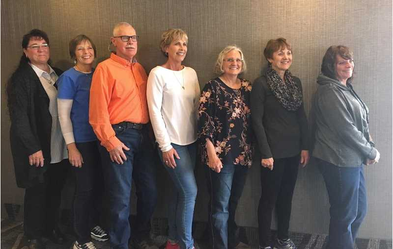 LON AUSTIN/CENTRAL OREGONIAN - Becky 'Boo' (Mitchell) Connolly, Cathy (McCabe) Lane, Tim Huntley, Cindy (Binder) Miller, Kristi (Garrison) Redd, Brenda (Cardin) Coats and Lori (Garrison) Meadows pose together for a photo during the recognition of the 1976 Crook County High School girls basketball team at Marshfield High School on March 7. The 1976 CCHS team finished second to Yamhill-Carlton at the first official OSAA-sponsored girls state basketball tournament.