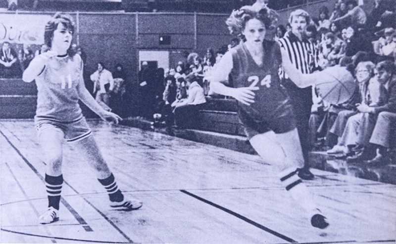 CENTRAL OREGONIAN FILE PHOTO - All-State Cowgirl guard Cathy McCabe drives past Kathy Buxton of Yamhill-Carlton in the finals of the Oregon State AA Girls Basketball Championships at Coos Bay.