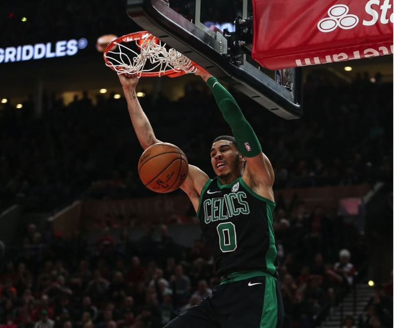 COURTESY FILE PHOTO: DAVID BLAIR - Jayson Tatum of the Boston Celtics dunks against the Trail Blazers.