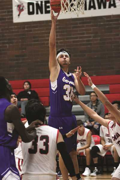 PMG PHOTO: PHIL HAWKINS - Gervais junior Auggie Guido led the Cougars in rebounding against Tri-River opponents, earning Honorable Mention considering in the end of season awards.