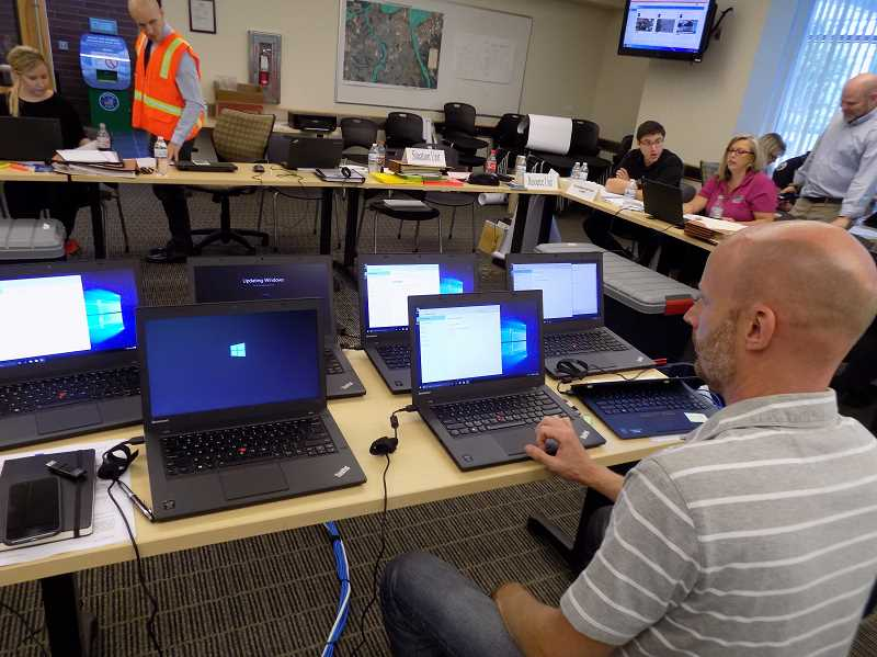 PMG FILE PHOTO - Heres how the Sherwood Emergency Operations Center looked like in 2016 when city staff ran through an earthquake preparedness scenario. Today, city staff and officials are conducting COVID-19 preparedness remotely to comply with social distancing.