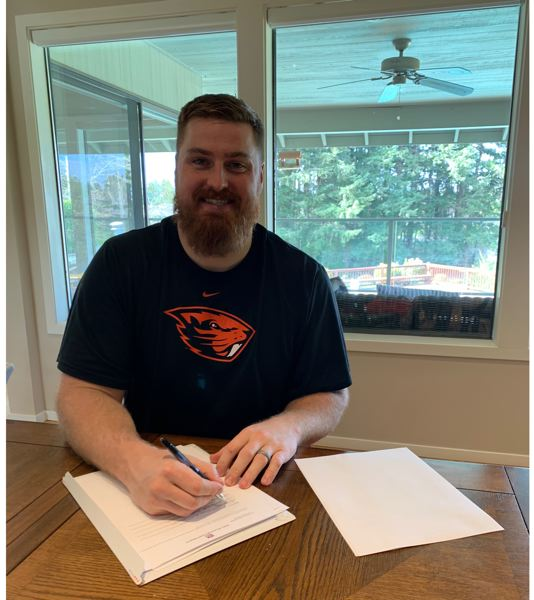 COURTESY PHOTO: MIKE REMMERS - Former Oregon State and Jesuit High star Mike Remmers signs a free-agent contract with the Super Bowl champion Kansas City Chiefs.