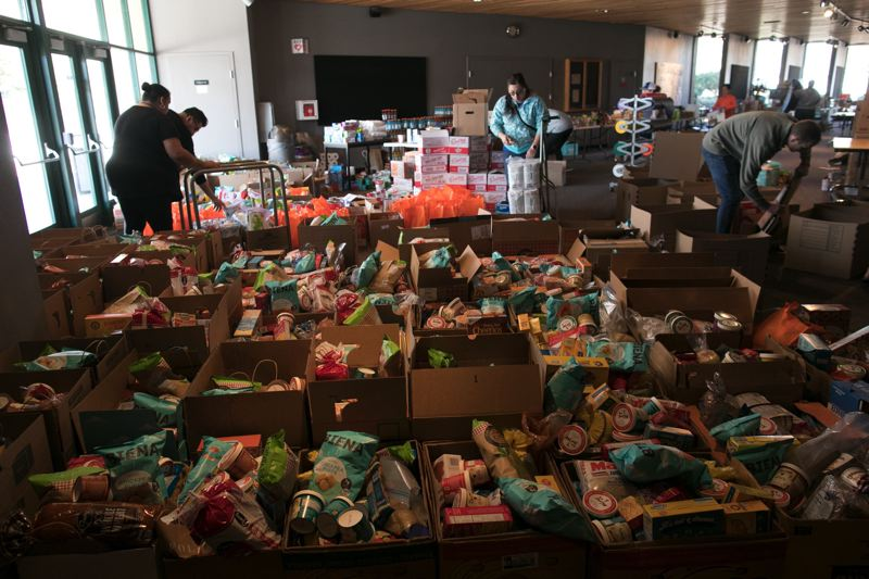 PMG PHOTO: JAIME VALDEZ - Boxes of food sits in the lobby of the Deb Fennell Auditorium at Tigard High School for Tigard-Tualatin families in need during the COVID-19 outbreak.