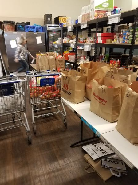 COURTESY PHOTO - Wilsonville Community Sharing prepares bags of food for curbside pick up.