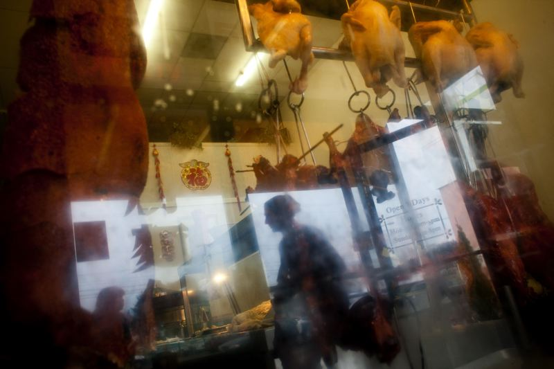 PMG FILE PHOTO - Pork and chicken hang in the window of the Best Taste Chinese BBQ Restaurant in an Asian shopping center along Southeast Division in the new Jade District.