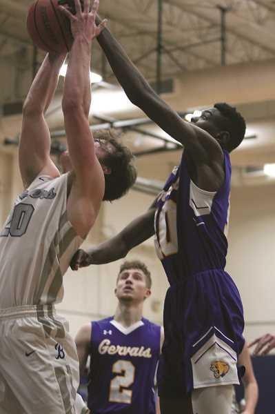 PMG FILE PHOTO: PHIL HAWKINS - Despite not making the 2019-20 Tri-River All-Conference team, junior post Brian Limage had a strong defensive season, leading the Cougars with 40 blocks while pulling down 96 rebounds in league play.