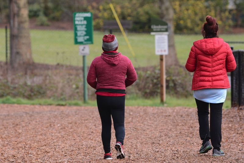PMG PHOTO: DAVID BALL - A pair of walkers give each other space on the wide two-mile fitness trail that surrounds Glendoveer Golf Course.