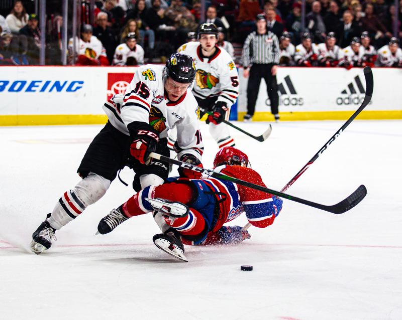 COURTESY PHOTO: MEGAN CONNELLY/PORTLAND WINTERHAWKS - Johnny Ludvig (left) of the Portland Winterhawks collides with a Spokane Chiefs opponent.