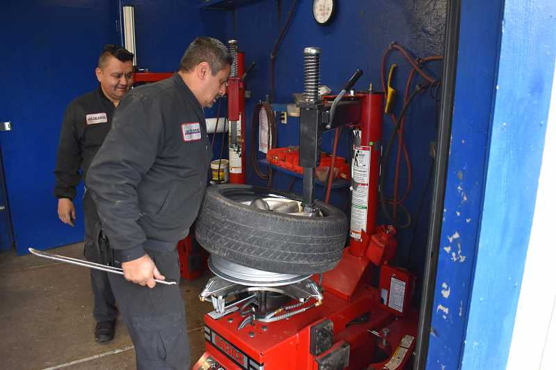 PMG PHOTO: RAYMOND RENDLEMAN - Luis Vega, the owner of Luis' Tire Service, isnt sure how long he'll be able to stay in business keeping essential drivers on the road.