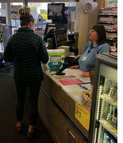 PMG PHOTO: RAYMOND RENDLEMAN - Walgreens employees in Oregon City handle a rush on toilet paper when they occasionally restock.