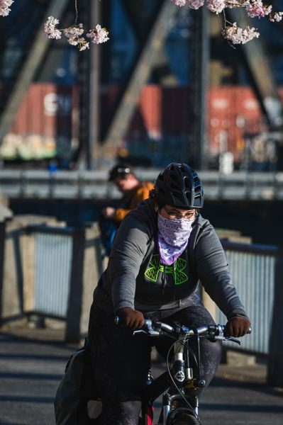 PMG FILE PHOTO - A biker rider masked in Portland's Waterfront Park.