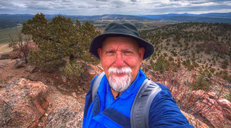 LON AUSTIN/CENTRAL OREGONIAN - The author takes a selfie from the summit of Barnes Butte just to prove he really did reach the summit. The view is looking south.