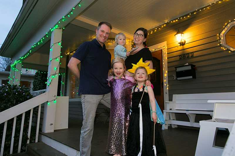PMG PHOTO: JAIME VALDEZ - Michael Cady Russell and Kate Russell, along with their three children. Like others in the city and across the U.S., the family decided to keep the holiday lights up on their home in Southeast Portland to spread cheer during a long stretch of quarantine.
