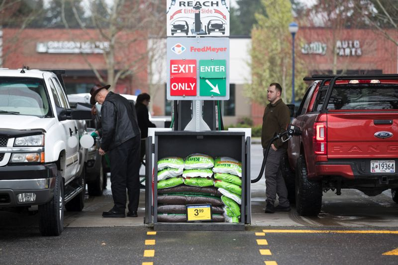 PMG PHOTO: ZANE SPARLING - Motorists fill up their own tanks at a Fred Meyer gas station in Wilsonville on Monday, March 30.