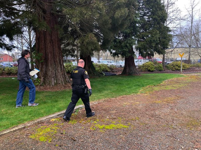 COURTESY PHOTO: WASHINGTON COUNTY SHERIFF'S OFFICE - A deputy with the Washington County Sheriff's Office looks to make contact with an unhoused person as part of outreach amid the coronavirus outbreak.