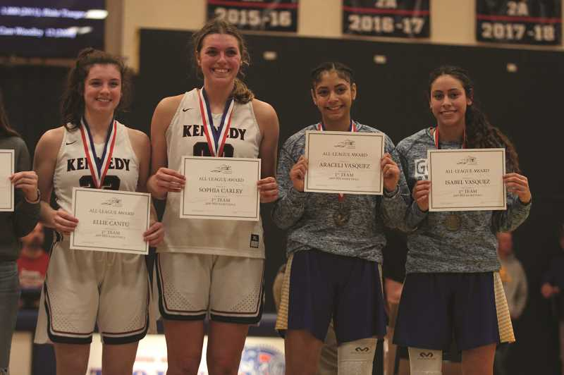 PMG PHOTO: PHIL HAWKINS - The Kennedy and Gervais girls basketball teams tied for 6th among 2A programs in GPA during the winter term with 3.71. From left, Ellie Cantu (Kennedy), Sophia Carley (Kennedy), Araceli Vasquez (Gervais), Isabel Vasquez (Gervais).